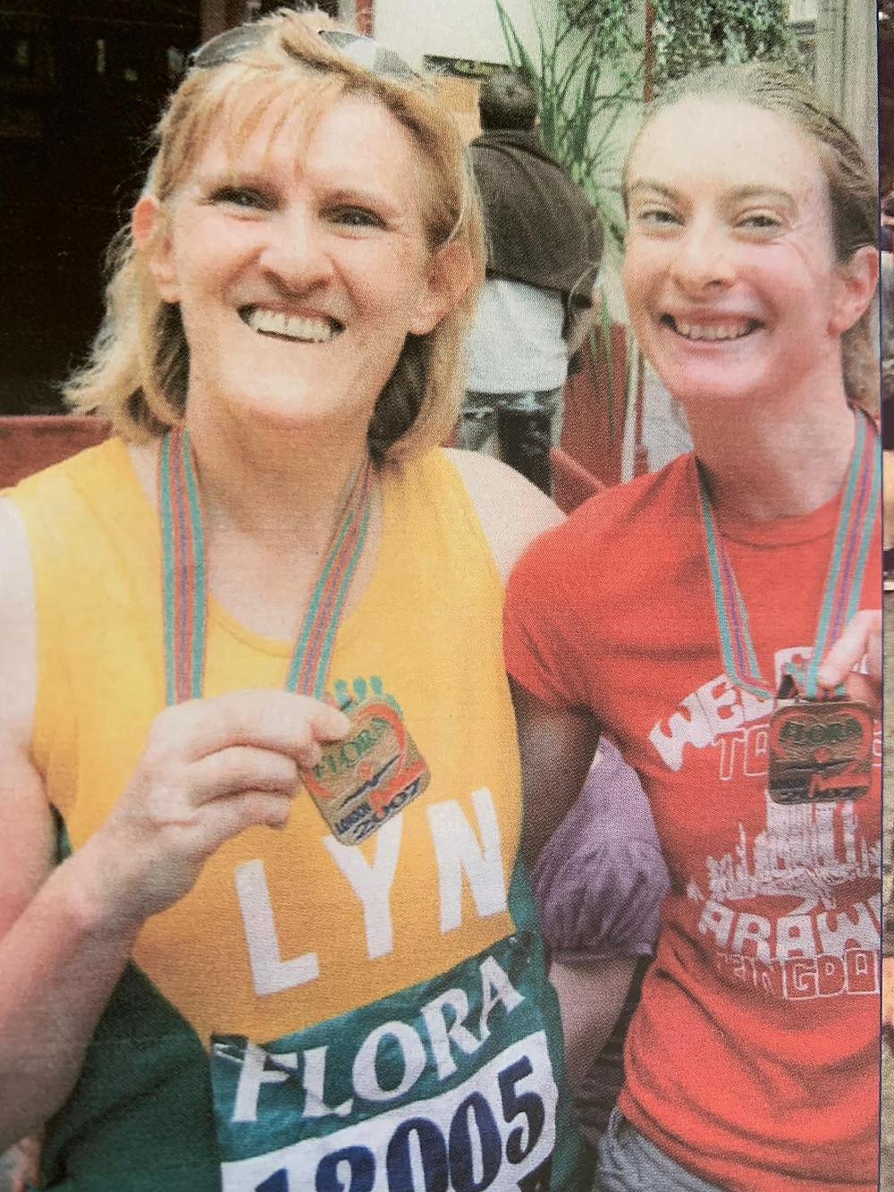 Eleanor and her mum running the London Marathon in 2017