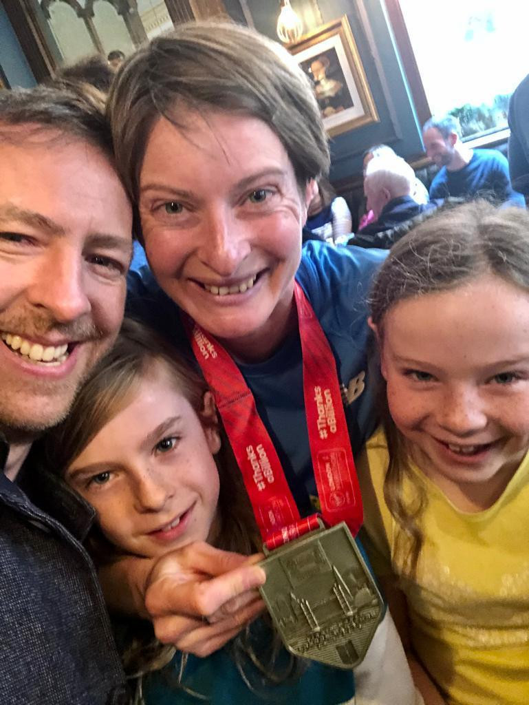 Eleanor finishing the 2019 marathon and celebrating with her family