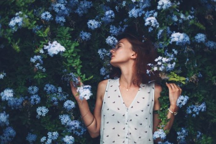 Woman-Surrounded-by-Flowers-700px