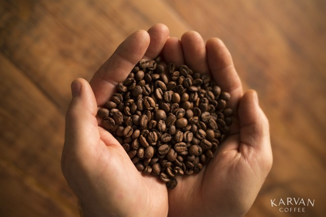 Karvan Coffee - hands - beans