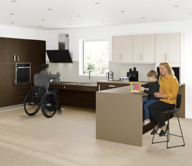 Large Freedom by Symphony multi-generational kitchen in aubergine and brown furniture with rise and fall sink unit to centre.
