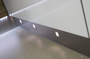 Plinth lighting in wheelchair accessible kitchen by Adam Thomas