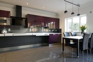 Large, open plan wheelchair accessible kitchen in dark plum and dark macassar effect by Adam Thomas
