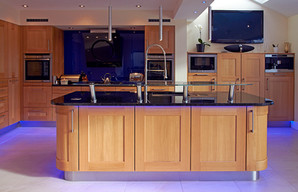 Designer oak accessible kitchen for specific impairment by Adam Thomas Consultancy