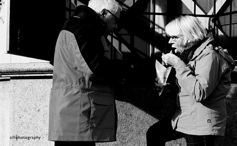 Project Normalness by documentary photographer Cilla Rijnbeek: an older married couple who are sharing fries in Den Bosch.
