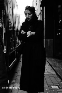 Project Normalness by Documentary Photographer Cilla Rijnbeek: beautiful woman in black in Antwerpen.