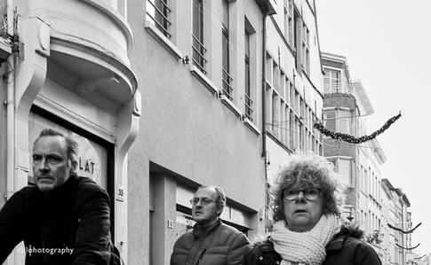 Project Normalness by documentary photographer Cilla Rijnbeek: three residents of Antwerpen making their way home.