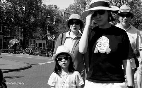 Project Normalness by documentary photographer Cilla Rijnbeek: a funny family who are all wearing black sun glasses and a t-shirt with a character who's wearing normal glasses.
