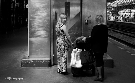 Project Normalness by documentary photographer Cilla Rijnbeek: a grandmother and her daughter with a pram waiting to take the elevator down.