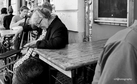 Project Normalness by documentary photographer Cilla Rijnbeek: a grandma looking at her smart phone liking posts of her elderly friends.