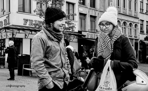 Project Normalness by documentary photographer Cilla Rijnbeek: smiling boy and a girl caught up in her own thoughts in winter clothing in the centre of Antwerpen.
