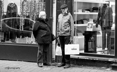 Project Normalness by documentary photographer Cilla Rijnbeek: an older married couple who are shopping for sweaters in Antwerpen.