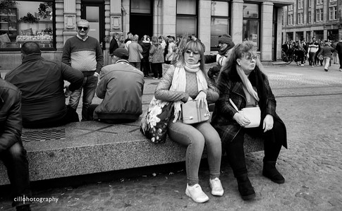 Project Normalness by documentary photographer Cilla Rijnbeek:  a mother and a daughter with funny big glasses on taking a break at the Dam.