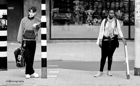 Project Normalness by documentary photographer Cilla Rijnbeek: a boy in a tracksuit and a woman waiting for a green light.