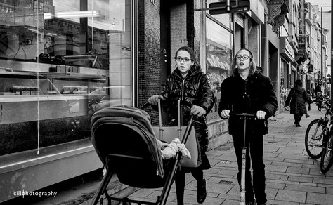 Project Normalness by documentary photographer Cilla Rijnbeek: two very young traditional Jewish kids behind a pram in Antwerpen looking like grown up parents.