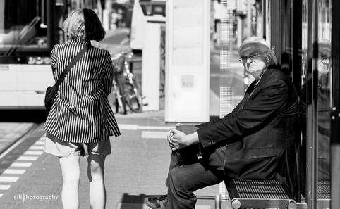 Project Normalness by documentary photographer Cilla Rijnbeek: an intellectual older man looking grumpy waiting at a straßenbahn stop in Berlin.