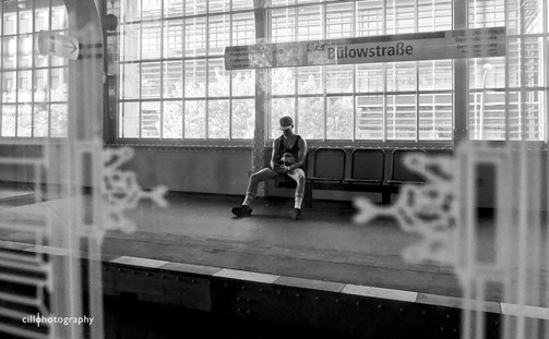 Project Normalness by Documentary Photographer Cilla Rijnbeek: a young man alone waiting for the U-bahn at Bülowstraße in Berlin.