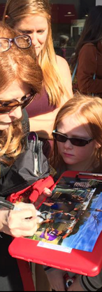 Donna DeLaney Cokenour signs autographs for a young fan