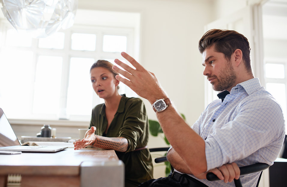 young-couple-at-home-office-discussing-w