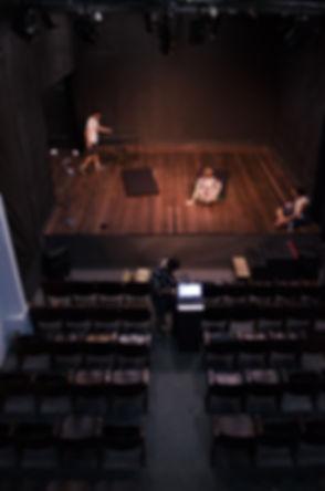 man-standing-on-stage-1049746.jpg