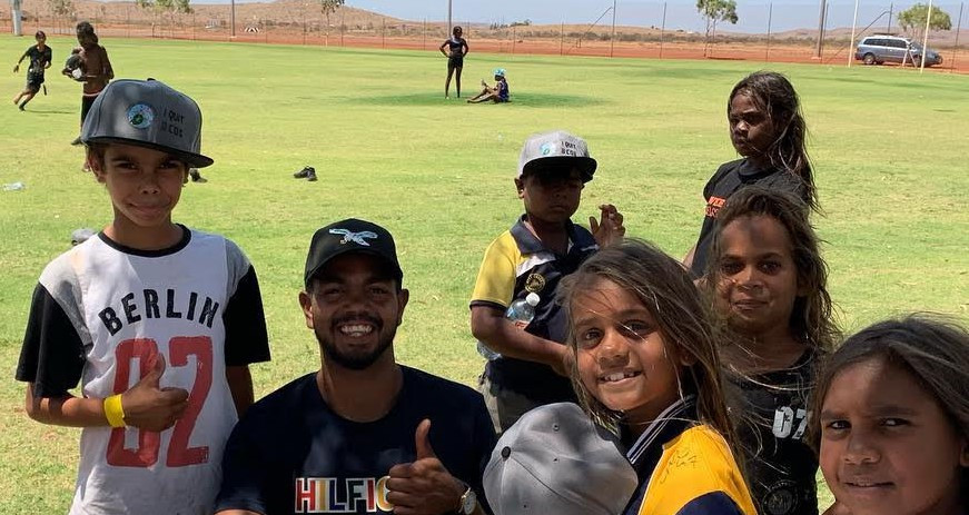 Willie Rioli with fans in Roebourne