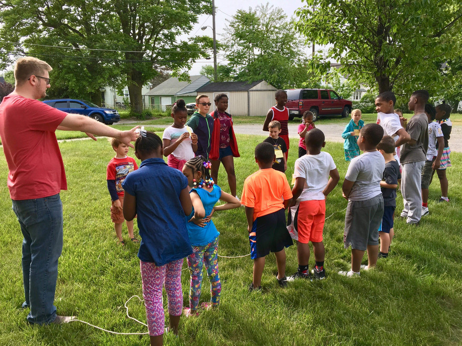Playing outdoor games.
