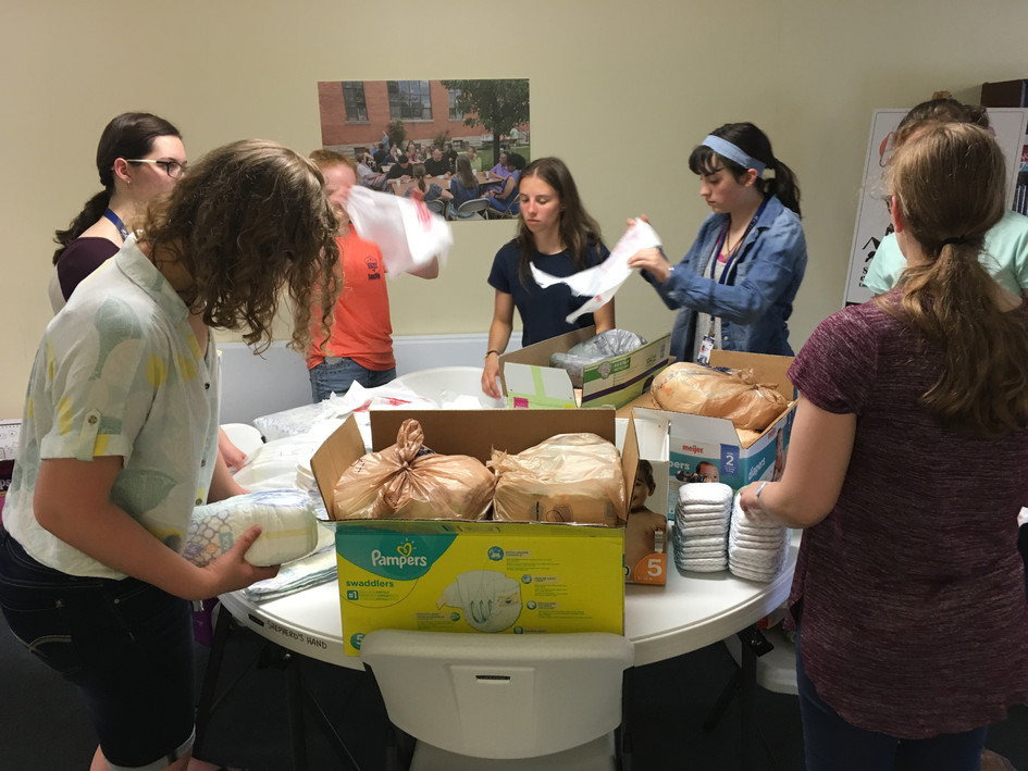 Volunteers from Christ Academy-Phoebe School at Concordia Theological Seminary pack diapers before our summer diaper giveaway.
