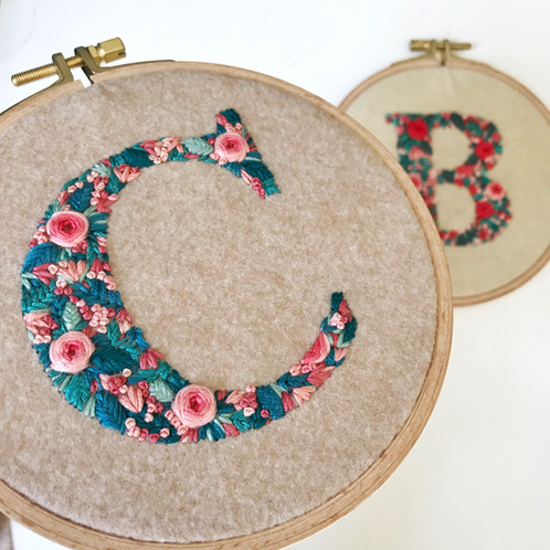 Hand embroidered floral initial on embroidery hoop