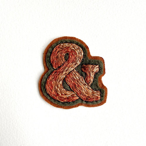 Brown-khaki ampersand hand embroidered patch