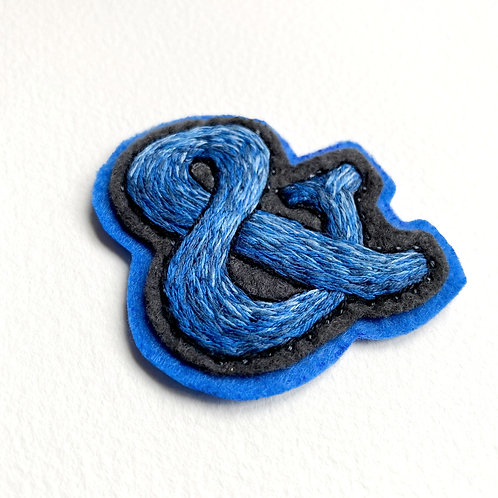 Blue-grey ampersand hand embroidered patch
