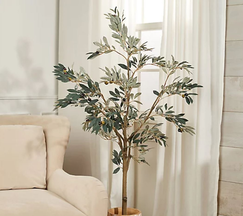 faux olive tree in basket planter