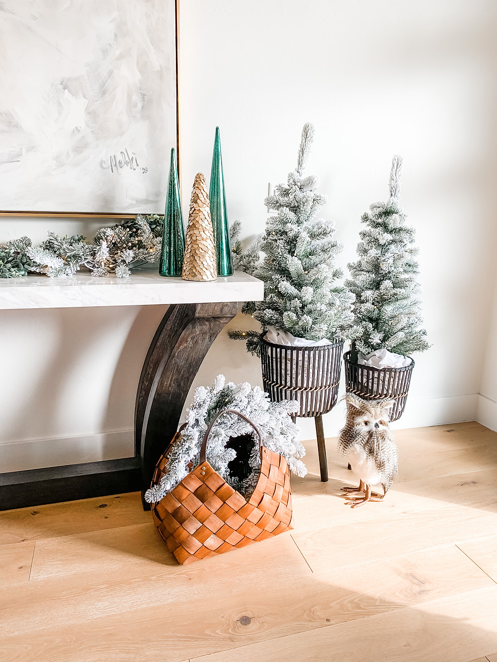 Modern Entryway Christmas Decor with Flocked Trees in Modern Black Plant Stands, Owl Decor and Flocked Pre Lit Wreath and Garland