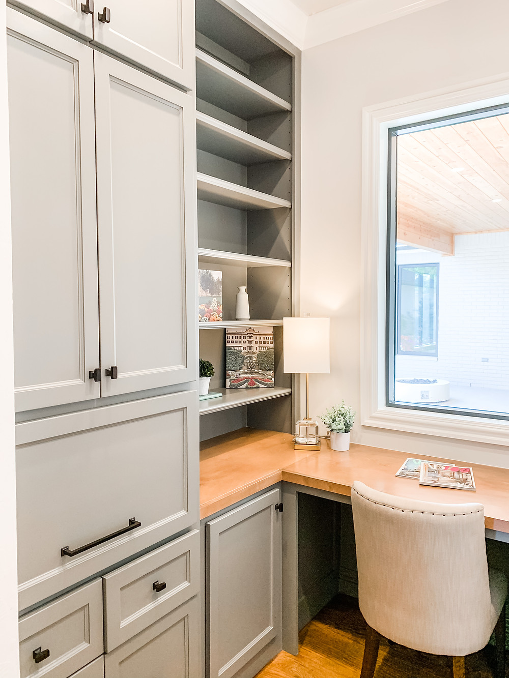 home office work from home space gray cabinets butcher block desk top home office storage built ins cabinets shelves