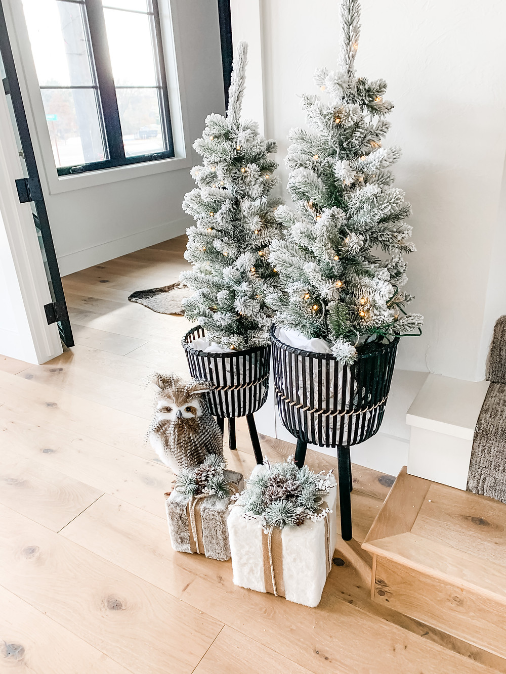 Christmas Trees in Modern Bohemian Black Plant Stands with Owl Decor and Faux Fur Present Box Decor