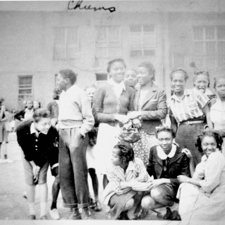 Students gather and take a picture with friends at Second Ward HS in 1940.