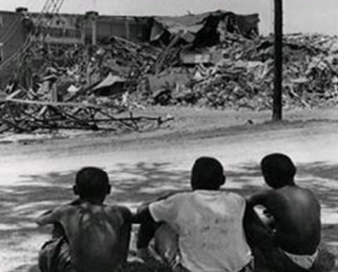 Children watch the Brooklyn neighborhood and Second Ward HS get bulldozed down.