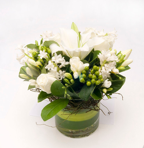 White mixed floral arrangement warringah florist manly vale florist a lovely arrangement of white and green flowers in a stylish glass vase please note freesias are seasonal and we may use an equivalent seasonal bloom mightylinksfo Images