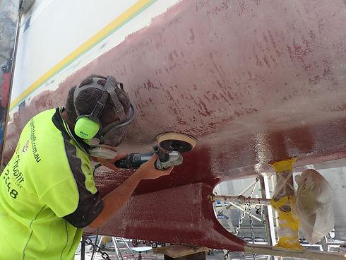 Sanding and fairing hull