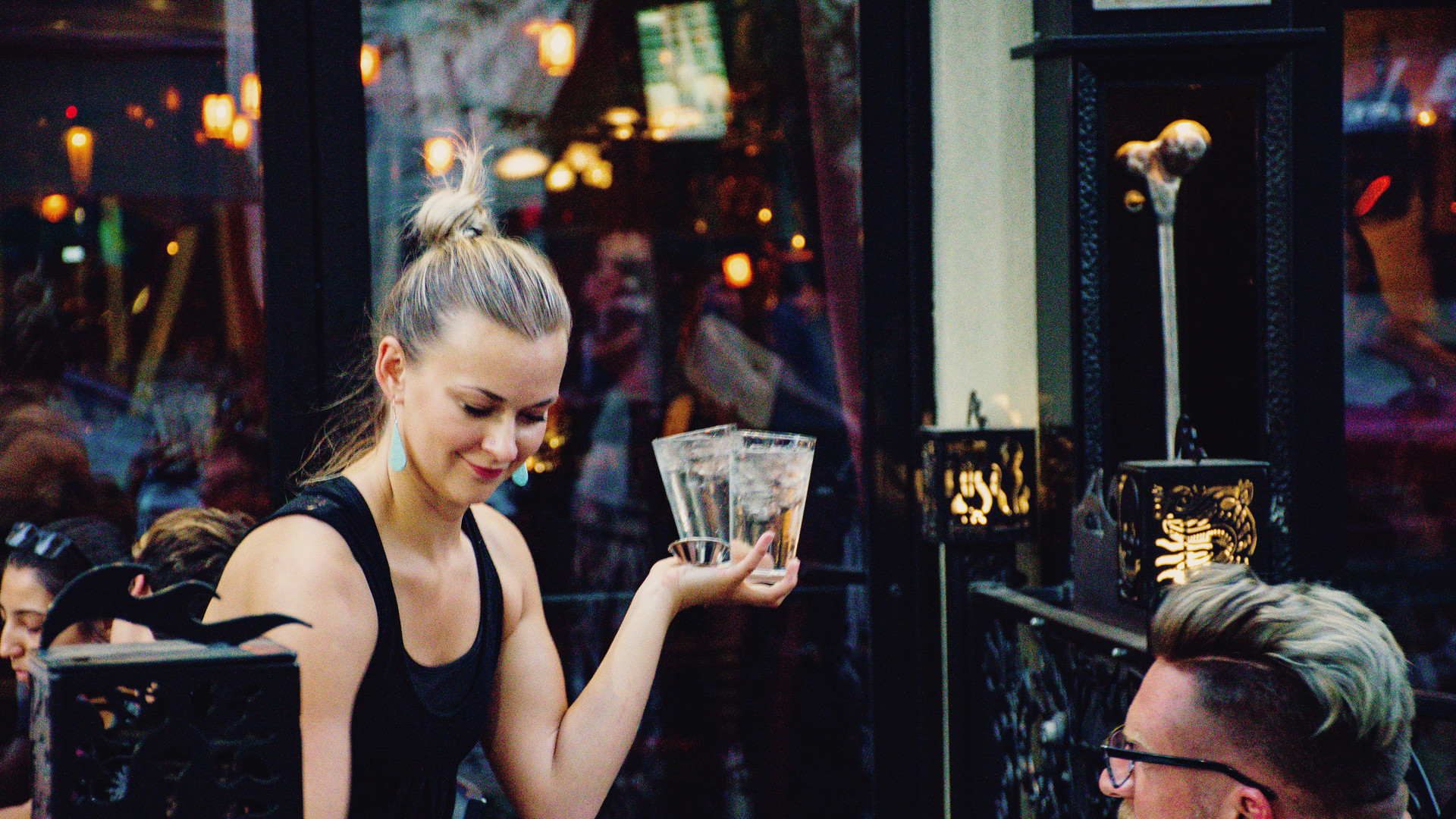 woman-holding-higball-glass-in-front-of-