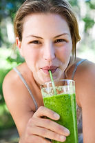 A-woman-drinking-green-smoothie.jpg