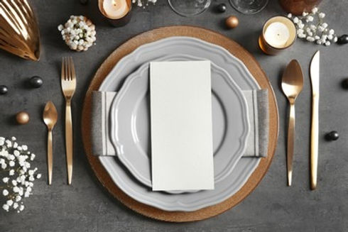 beautiful-table-setting-on-grey-260nw-596407646_edited.jpg