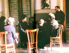 padre-pio-gathered-around-his-spiritual-children-discussing-religious-topics-and being taught-on-how-to-get-to-heaven-pamphlets-to-inspire