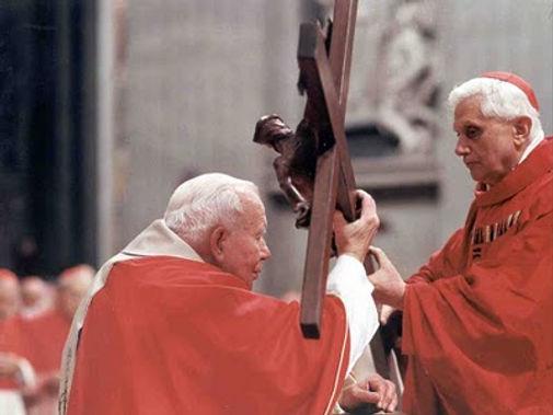 john-paul II-accepting-cross-from-cardinal-ratzinger-to-begin-stations-of-the-cross-during-Lenten-observance-pamphlets-to-inspire