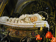 maria-bambina-blessed-mother-as-a-child-wrapped-in-a-white-and-gold-baby-outfit-pamphlets-to-inspire