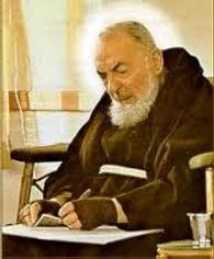 padre-pio-thoughtfully-writing-inspirational-words-to-a-spiritual-child-pamphlets-to-inspire