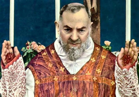 padre-pio-blessing-at-end of-a mass-with-stigmata-visible-at-our-lady-of-grace-church-in-san-giovanni-pamphlets-to-inspire