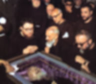 padre-pio-in-his-coffin-while-brother-friars-look-on-pamphlets-to-inspire