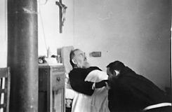 padre-pio-comforted-by-a-fellow-friar-after-confrontation-with-the-devil-pamphlets-to-inspire