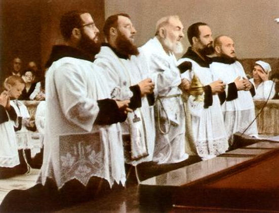 padre-pio-celebrating-holy-mass-with-his-assistance-pamphlets-to-inspire