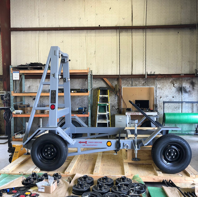 Part Number: 200-000-101  DESCRIPTION  Four wheeled trailer with brakes, leveling jacks, tie down rings, pintle hook, tow bar and tool box.  FUNCTION  The trailer is designed to transport and store the Alison T56-A14 engine.